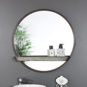 rustic round mirror with small shelf across the middle