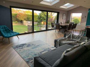 Family room with sofa facing outdoors